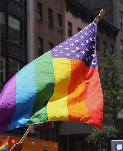 Two men harassed a queer couple because their rainbow flag has stars and stripes. - JMAZZOLAA ON FLICKR