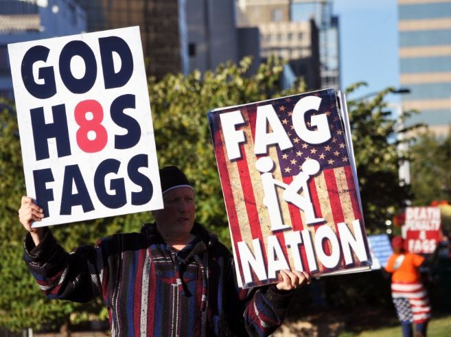 Westboro Baptist Church protesters at the World Series. - DANNY WICENTOWSKI
