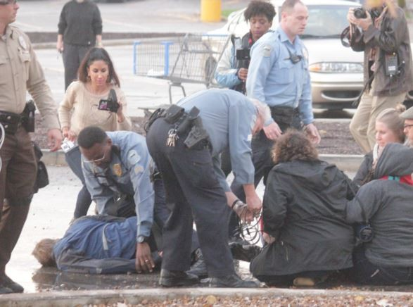 Ferguson police officers arrested four protesters at the area's Walmart. - DANNY WICENTOWSKI