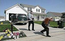 Investigators outside the Coleman home in May 2009.