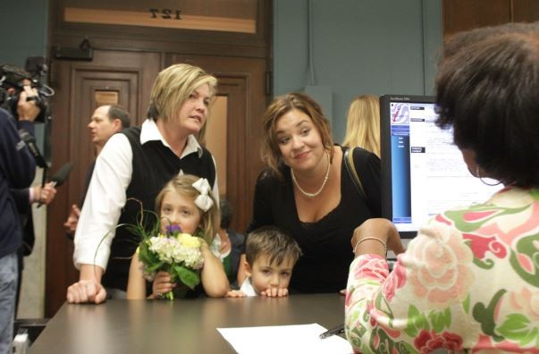 Kelley Harris and Kelly Barnard, of St. Louis, brought the whole family along with them to the Recorder of Deeds office.