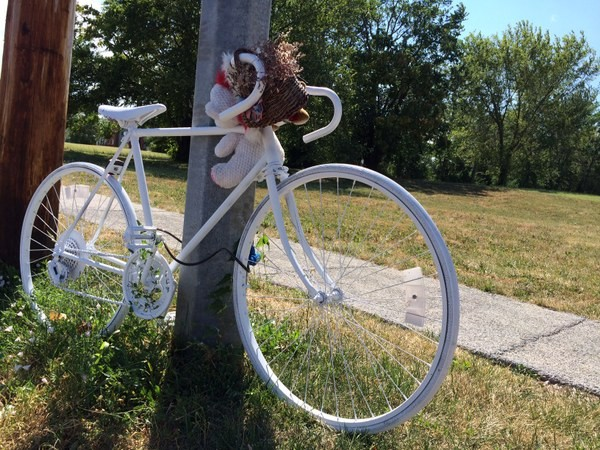 A bike memorial still marks the spot where Rick Beard was struck and killed by a motorist last month. - LINDSAY TOLER