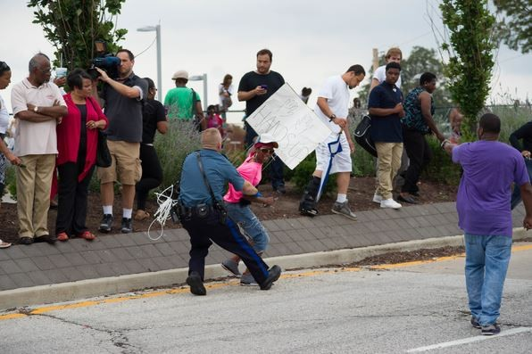 One of the 32 protesters arrested yesterday during a failed attempt to block I-70. - BRYAN SUTTER