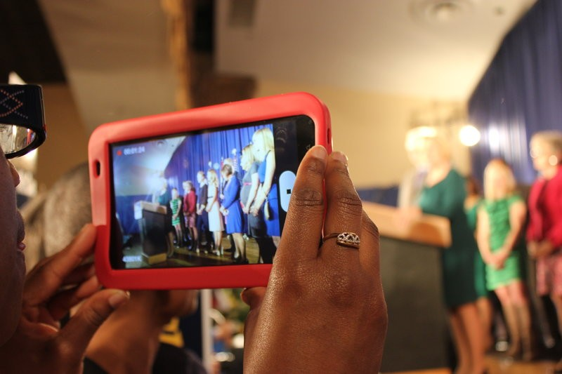 A woman films McCaskill's speech with her iPad. - LEAH GREENBAUM