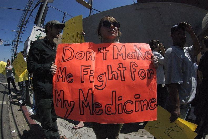 Activists protest DEA raids on medical marijuana facilities in California. - WIKIMEDIA/SHAY SHOWDEN