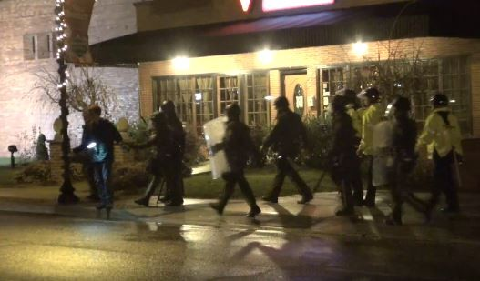 Police arrest Trey Yingst, on the left with a flash hanging from his neck, on November 22 in Ferguson. - ALEXJONESLIVE LIVESTREAM
