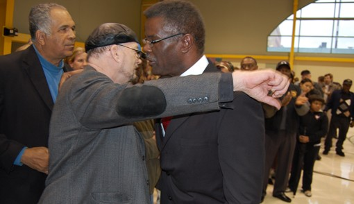 Brown hugs a line of supporters after saying his piece. - PHOTO: NICK LUCCHESI