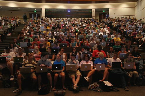 Everyone in this photo needs to hock that Macbook NOW. - FLICKR VIA J-SCHOOL BUZZ