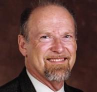 David A. Peters slides head-first.
