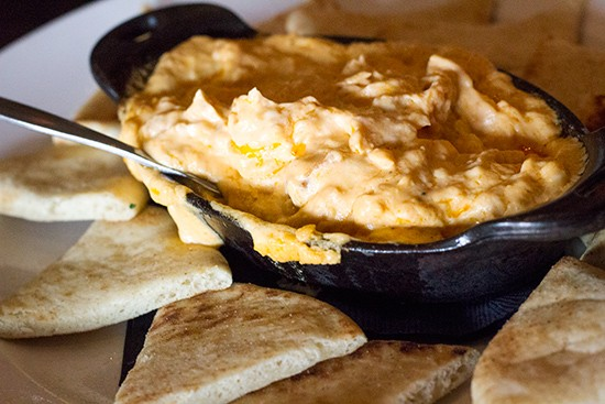 Buffalo chicken queso with flatbread.