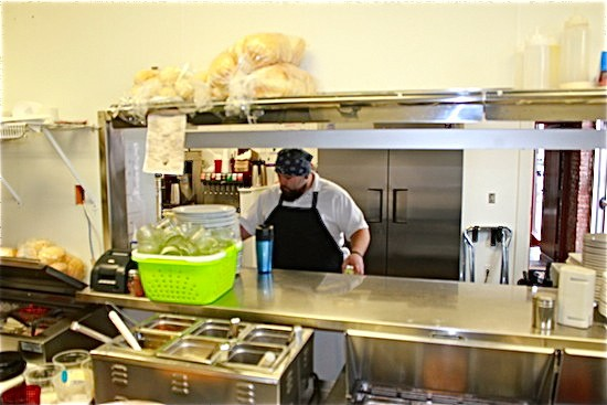 Rick Lewis works in the kitchen of Quincy Street Bistro. - IAN FROEB