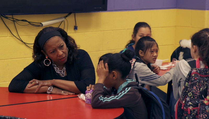Principal Donnie Harris (now retired) helps her students make sense of life in a new land in this scene from Day One. - BRIAN O'CONNELL