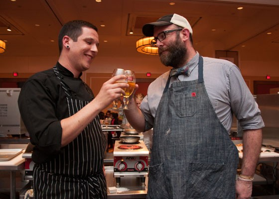Chefs Brian Coltrain and John Perkins toast with the secret ingredient, Stella Artois, at Iron Fork 2014. | Micah Usher