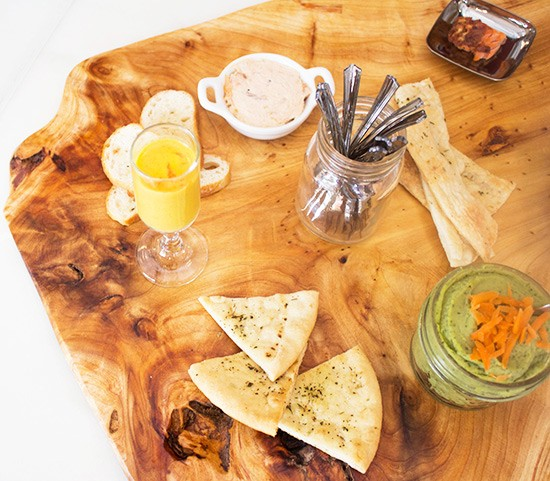 A selection of the Station's market offerings: crostini, pita chips, carrot ginger soup, basil white bean dip, maple glazed smoked salmon dip.
