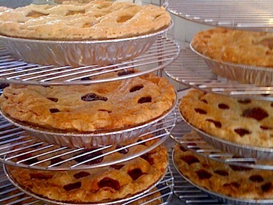 Pies cooling on racks at Sugaree Baking Company.