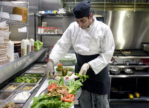 Chef Wesam Hamed preparing the hummus plate. See more photos from inside Ranoush. - PHOTO: JENNIFER SILVERBERG