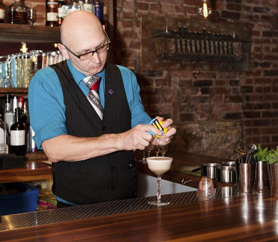 Mixologist Ted Kilgore at work behind the bar of the new Taste - LAURA ANN MILLER