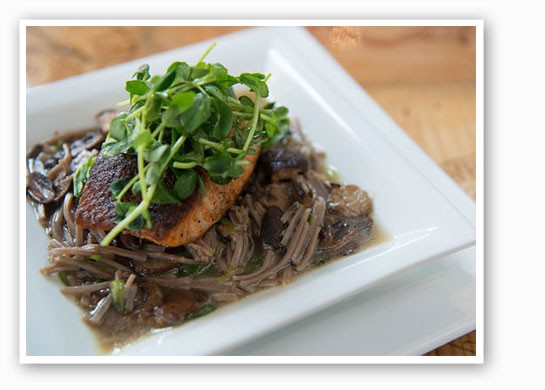 Salmon over soba noodles in a mushroom Dashi with pea shoots. | Corey Woodruff