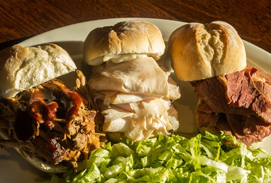"Monty's ""Slider Trio"" with pulled pork, hand-carved turkey and pastrami. 