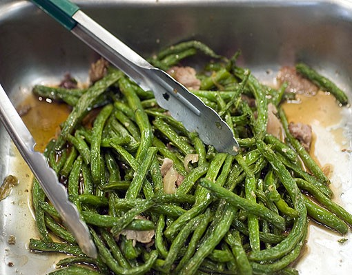 The green beans with pork at the buffet counter are called Dâu Sao Thit Heo. See more photos from the kitchen of Phuc Loi in this slideshow. - PHOTO: JENNIFER SILVERBERG