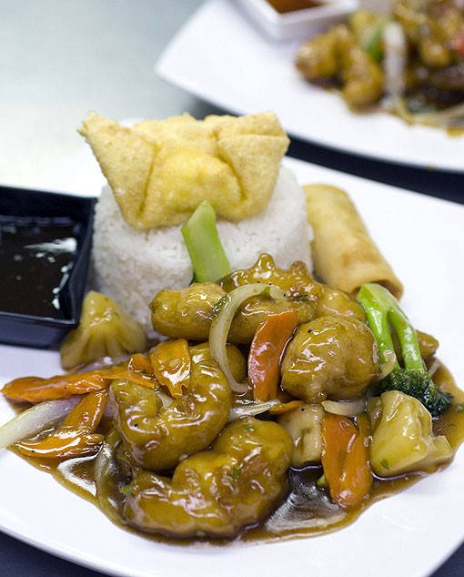 Thai Braised Chicken, also a lunch special, is made with white meat chicken, pineapple, onions and red & green peppers. Like all the lunch specials, it is served with steamed rice a crab rangoon, crispy spring roll and dipping sauce. See a photo slideshow here. - PHOTO: JENNIFER SILVERBERG