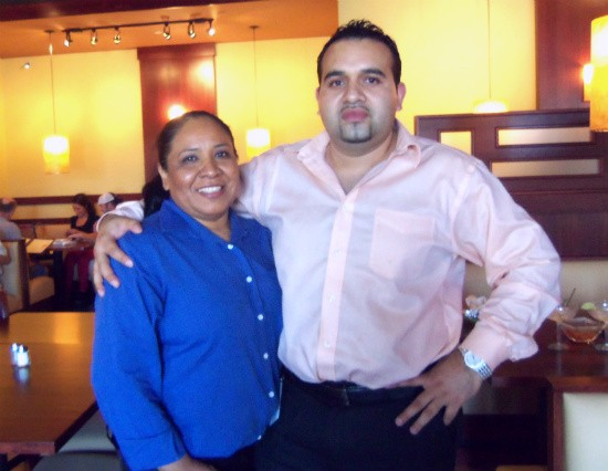 Fiesta co-owner Roger Aguirre and his wife Estella in the restaurant's dining room. - EMILY WASSERMAN
