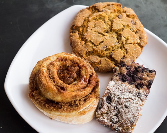 Cinnamon roll, peanut-butter chocolate-chip cookie, blueberry quick bread baked in house.