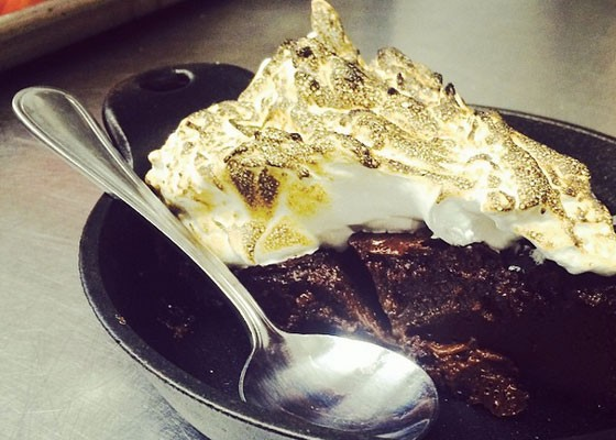 Smoked cast iron s'mores pie at Quincy Street Bistro. | Instagram/Rick Lewis