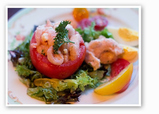 Tomato stuffed with laughing bird shrimp from Tripel Brasserie. | Mabel Suen