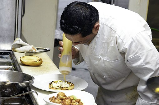 Julio putting the mustard on a chicken sandwich. See more photos from Molly's in our slideshow. - PHOTO: STEVE TRUESDELL