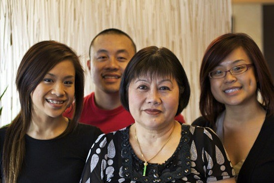 Mai Lee founder Lee Tran (front center) with children (from left) Linda Tran, Qui Tran and Sara Tran - JENNIFER SILVERBERG