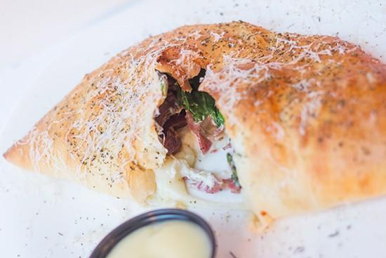 "The ""Gonzo"" with salami, dates, spinach, boursin, mozzarella, mascarpone, ricotta, garlic oil and garlic butter sauce."