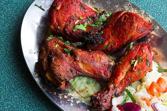Chicken tandoori, chicken marinated in yogurt with Indian herbs and spices.