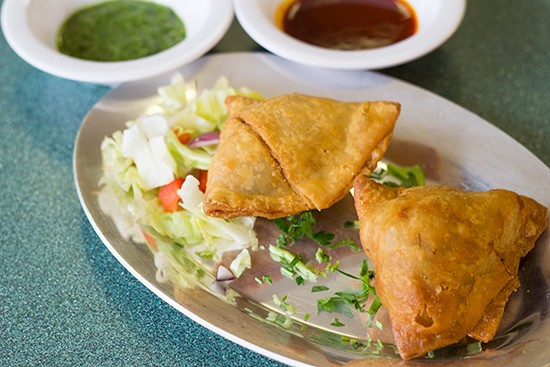Vegetable curry samosa with potatoes and peas.