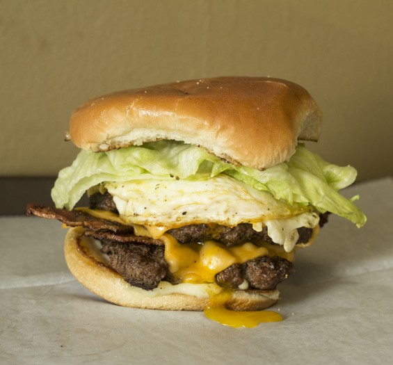 "The ""Garbage Burger"" with lettuce, bacon, egg, onion, cheese and mayo. 