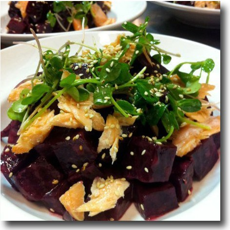 Bork's roasted beets with smoked salmon, pea shoots and sesame seeds. - HOLLY FANN