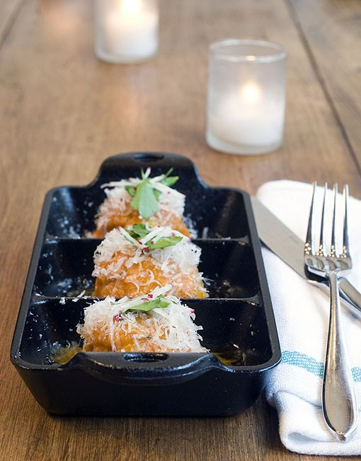 Spicy pork meatballs are plated in cast iron dishes to complement the rustic/ schoolhouse environs of Taste. See a slideshow of photos from Taste by Niche. - PHOTO: JENNIFER SILVERBERG