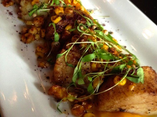 Scallops with ancho-roasted corn, micro cilantro and charred tomatoes at Vino Nadoz | Holly Fann