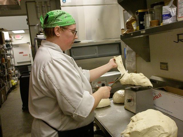Harden weighs bread dough. - ROBIN WHEELER