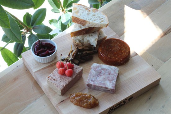 House-made terrine board: (counterclockwise from upper left) pickled beets; chicken-liver pâté with pickled cherries; peach butter; ciccioli; goat and harissa; pickled shiitake mushrooms. | Evan C. Jones