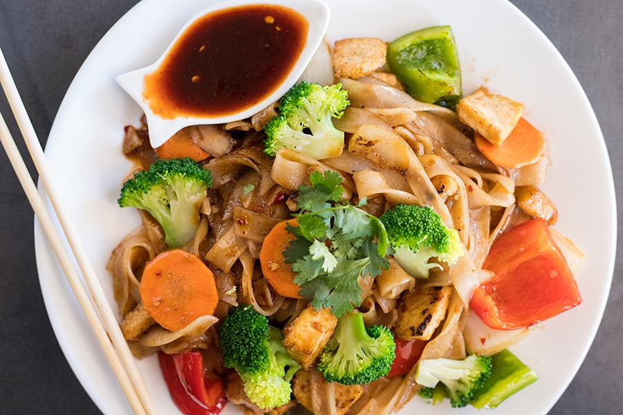 """""""Drunken noodles"""" coat tofu, peppers, onion, carrots and broccoli with a delicious umami fish-sauce flavor. - MABEL SUEN"""