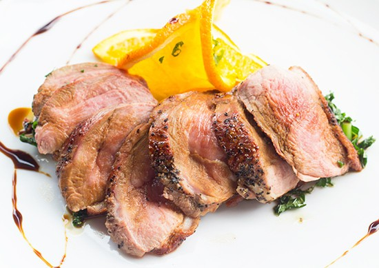 """Espresso Peking Duck,"" duck breast with sorghum citrus glaze and crispy kale."