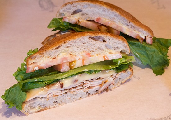 "The ""Truffles Turkey"" with smoked Buttonwood Farm's turkey, bacon, brie, lettuce, local tomato and Dijon aioli."
