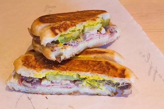 "The ""Castro"" with mojo-braised pork, Butchery-smoked ham, Swiss cheese, pickles and mustard."