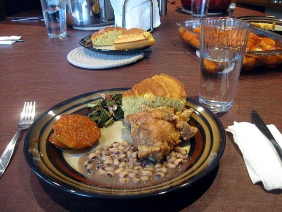 Clockwise from left: sweet potatoes, collards, cornbread, fried chicken, black-eyed peas. - AIMEE LEVITT