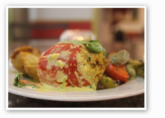 Tomatoes stuffed with a goat cheese sauce. | Nancy Stiles