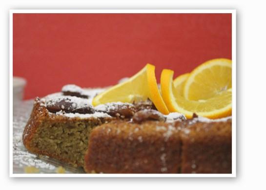 Orange cake with warm dates and sesame glaze.