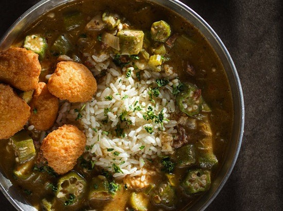 Corn fritters garnish the seafood gumbo at the Kitchen Sink | Jennifer Silverberg