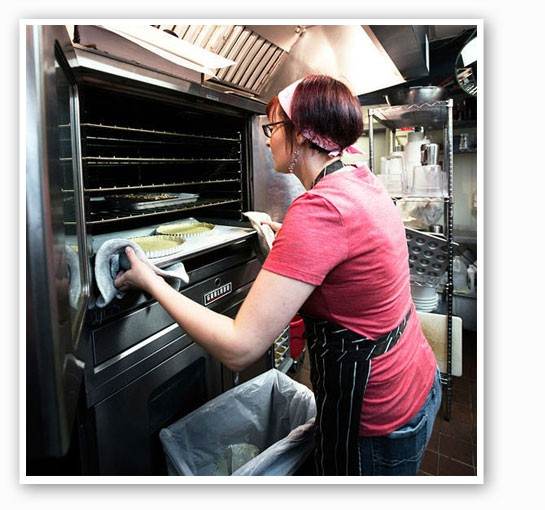 Owner Christy Augustin removes pie crusts from the oven. | Jennifer Silverberg
