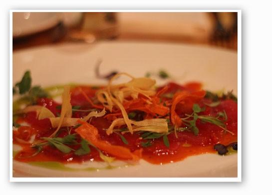 Thin and raw Ahi tuna with citrus, carrot soy glaze, Fresno chiles and cilantro. | Nancy Stiles